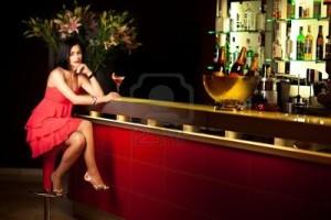 woman-sitting-at-bar
